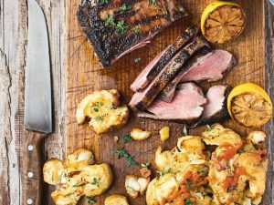 Barbecued marinated lamb with smashed potatoes